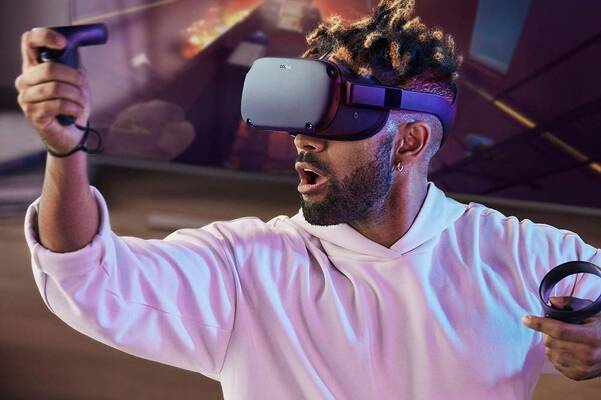#1. Oculus Quest 64GB Virtual Reality Gaming Tracking Beyond Room-Scale Touch Controllers