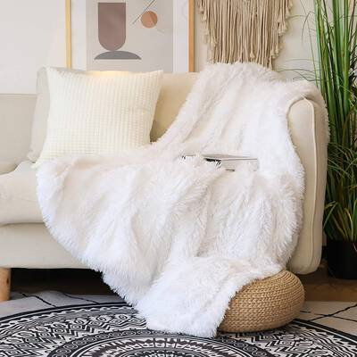 9. Tuddrom Pure White Fuzzy Lightweight Decorative Soft Faux Fluffy Throw Blanket for Couch Sofa